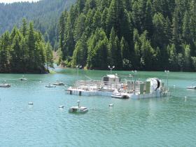 The hydrophones floating around the fish collector are doing 3-D mapping and gathering data on the fish in Cougar Reservoir.