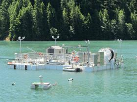 The Portable Floating Fish Collector will be at Cougar Reservoir for the next two years, catching newly-hatched wild Chinook Salmon to be transported to the bottom of Cougar Dam.