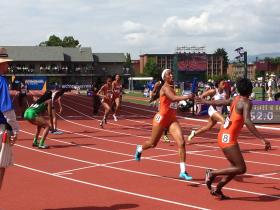 Passing the baton in the Women's 4X400 meter relay, the final event of the 2014 Outdoor Track & Field Championships at Hayward Field in Eugene, Oregon.