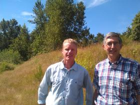 Joe Moll with McKenzie River Trust (left) and Randy Hledik of Wildish Company at Green Island.