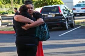 Two Reynolds High School students embrace before a vigil at the Portland Greater Baptist Church following a deadly shooting at their school.