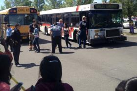 """Reynolds High School students exit TriMet bus after being transported from the school to the Wood Village Fred Meyer to meet up with their parents.""  -- OPB"