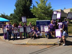 Workers picket for fair wages and benefits June 19, 2014 in front of Samaritan North Lincoln Hospital in Lincoln City.
