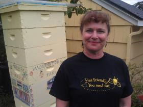 Lisa Arkin of Beyond Toxics with her backyard beehive in Eugene.