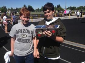 Will Holt, Aodhan McGlynn, and their solar powered race car.