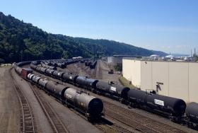 Tank cars, many of them placarded as holding crude oil and other hazardous materials, sit in a BNSF yard in Northwest Portland.