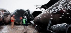 NTSB Board Member Robert Sumwalt views damaged rail cars on scene of BNSF train accident in Casselton, N.D.
