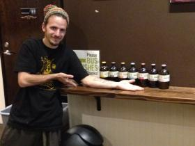 Jason Wellman poses with several flavors of Brew Dr. Kombucha, a Portland business.