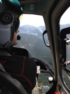 Helicopters are being utilized for bucket drops to slow the progress of the fires.