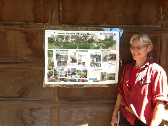 BLM Botanist Jennie Sperling stands next to a poster at the former home of Howard Hinsdale.