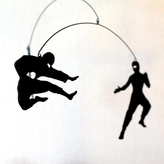 Andrea Leggitt's laser etch mobiles draw on memes in popular culture, such as ninjas.