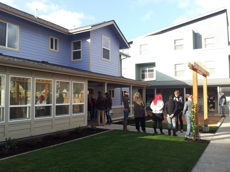 Crowd begins to gather in front of Bothy Cottage ahead of grand opening.