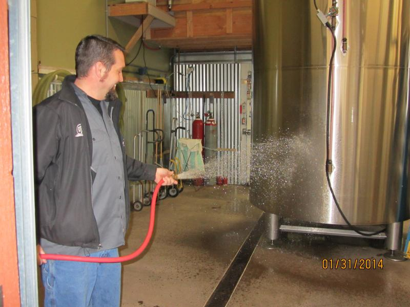 Matt VanWyck washes down a tank at Oakshire.