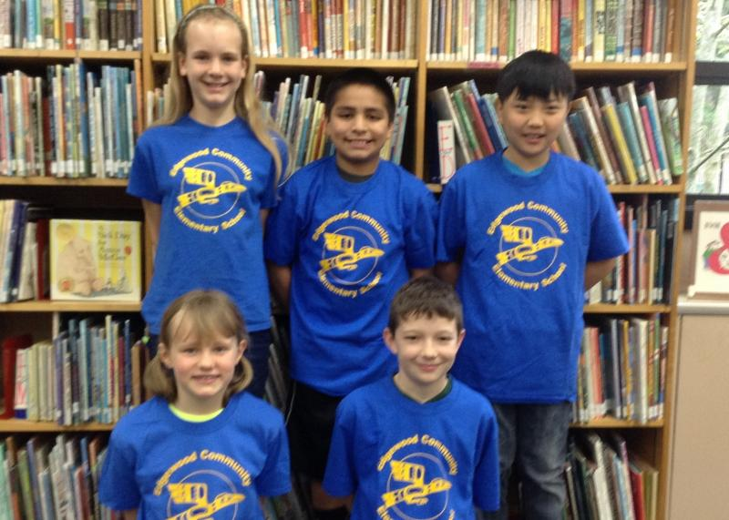 Wearing their Edgewood shirts in the school library, Kelsey Bouse (3rd grade), Michael Ahn (5th), Katelyn Bouse (5th), Sam Collier (5th) and Jose Santiago (5th).