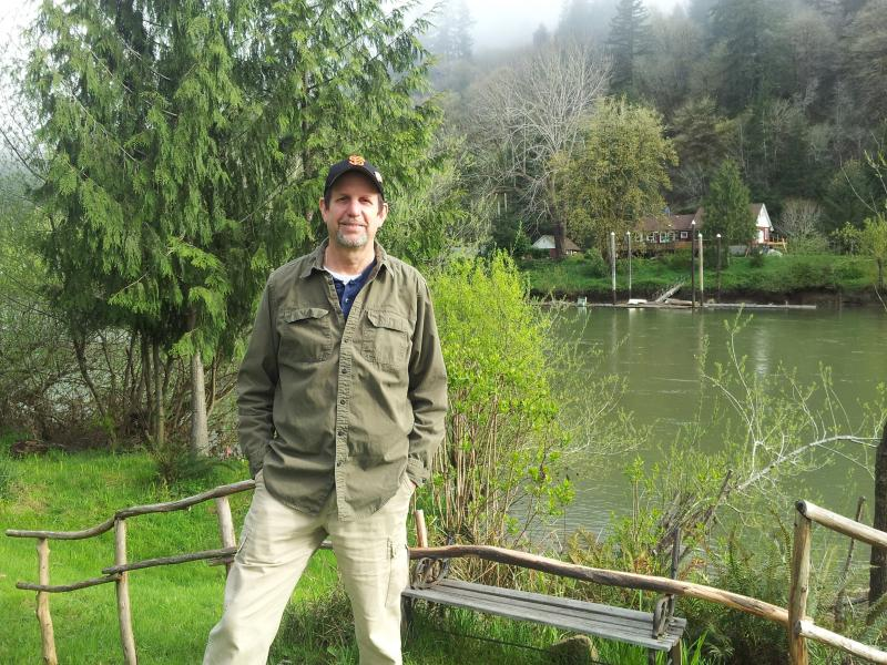 Outdoor education volunteer Jim Grano stands by the Siuslaw River in Mapleton.