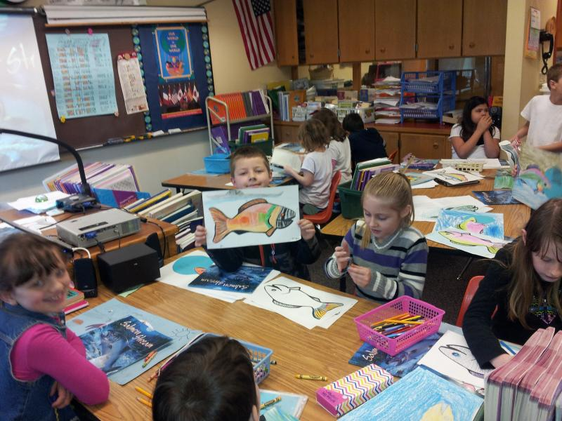 Students work on salmon art in Dolly Green's class.