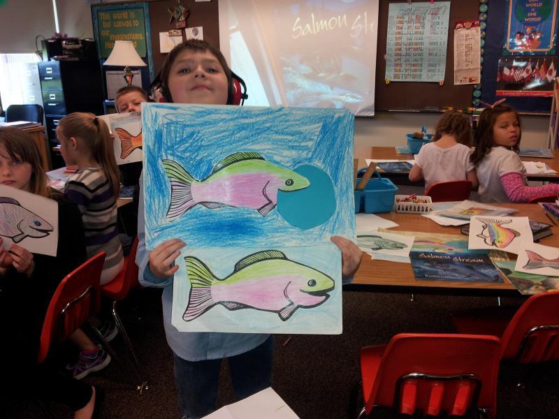 Siuslaw Elementary student displays salmon life-cycle classwork.