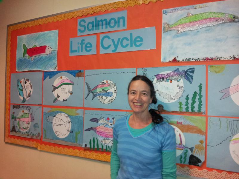 Siuslaw Elementary School teacher Dolly Greene shows her class's ecology work.