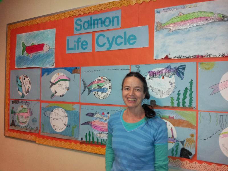 Siuslaw Elementary School teacher Dolly Greene shows her class's ecology work.
