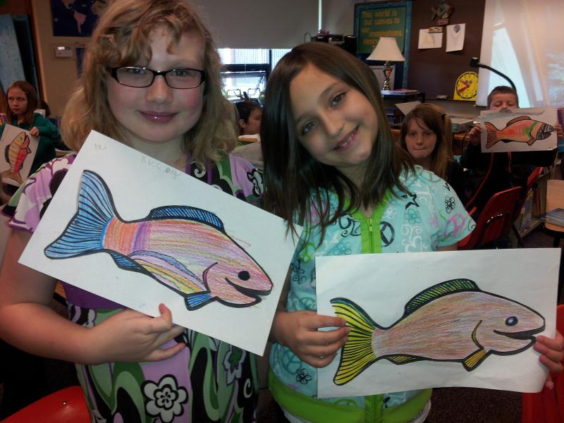 Students in Dolly Greene's 3rd grade class show off salmon art.