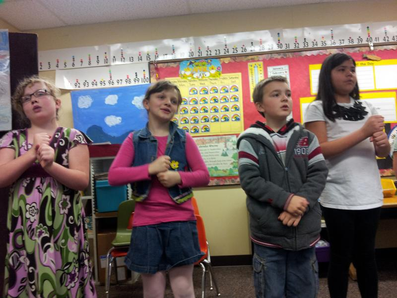 Students sing song about salmon.
