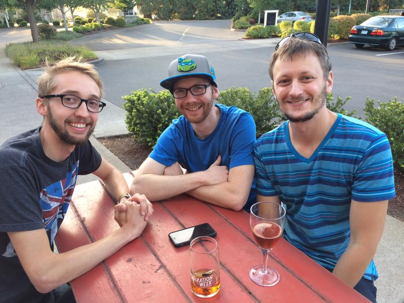 """Tyler McNeiil (center) with friends Josiah Austin (left) and Brent Davis (right) at Goose Island """"Migration Week"""" event."""