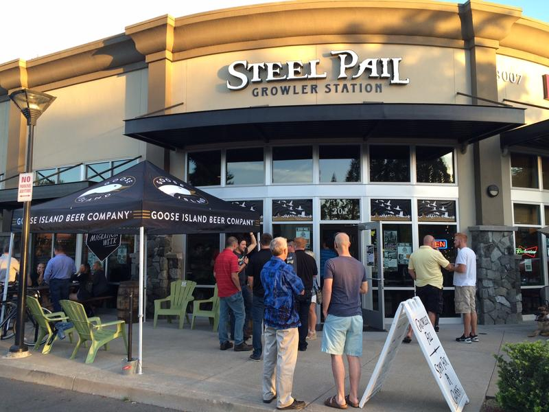 """Patrons gather at Eugene's Steel Pail Growler Station for Goose Island's """"Migration Week"""" event."""