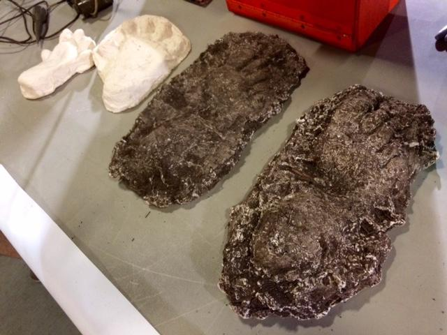 Plaster foot and hand casts believed to be from Sasquatch imprints.