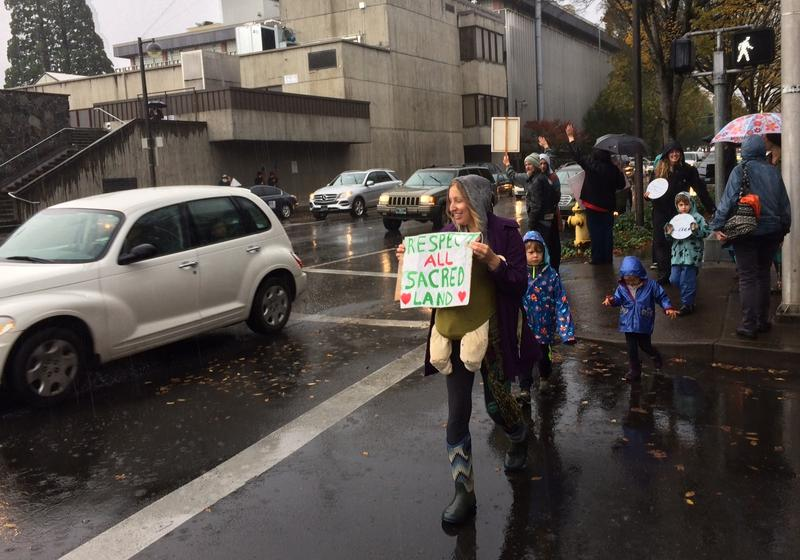 Passing cars honk their support for the solidarity rally in downtown Eugene.