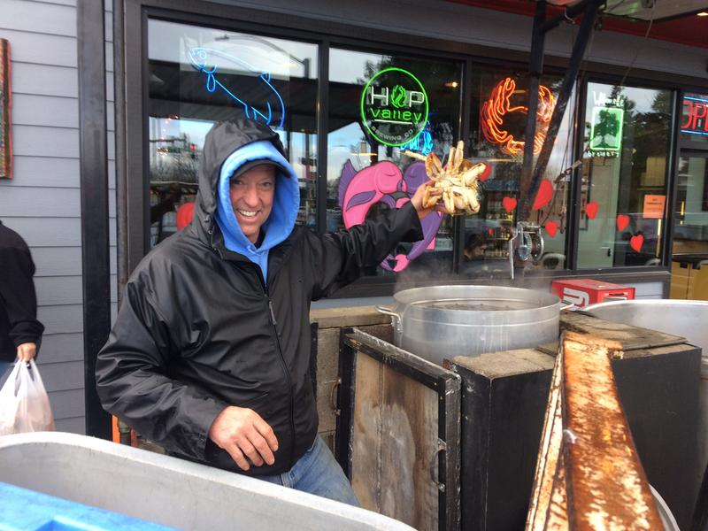 Ryan Rogers, owner of Fisherman's Market, dunks some crabs.