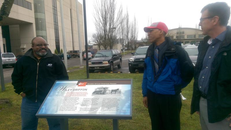 Eugene City Councilor Greg Evans (left), Lane County NAACP Executive Director Eric Richardson, and EWEB General Manager Frank Lawson (right) with new plaque honoring Wiley Griffin.
