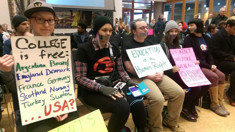 Students at the Trustees meeting held protest signs and spoke urging the board to not increase their tuition.
