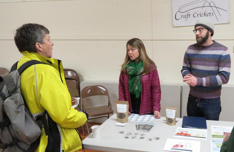Several curious Audobon Society members check out Craft Crickets' table.