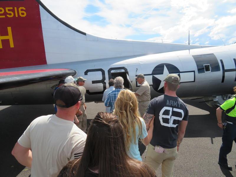 Visitors prepare to board the Aluminum Overcast