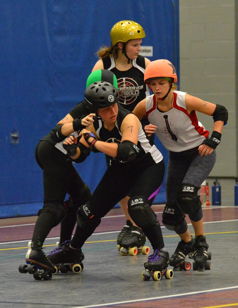 Members of the Reservoir Dolls team scrimmage ahead of this weekend's tournament.
