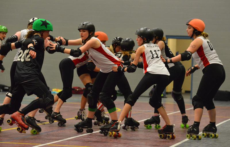 Scrimmage between black and white team members of Reservoir Dolls.