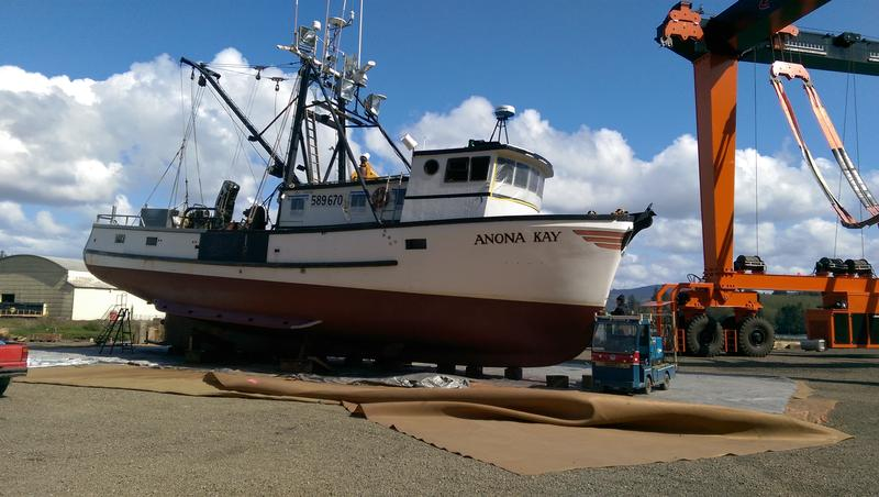A boat getting its hull re-painted at the Toledo shipyard.