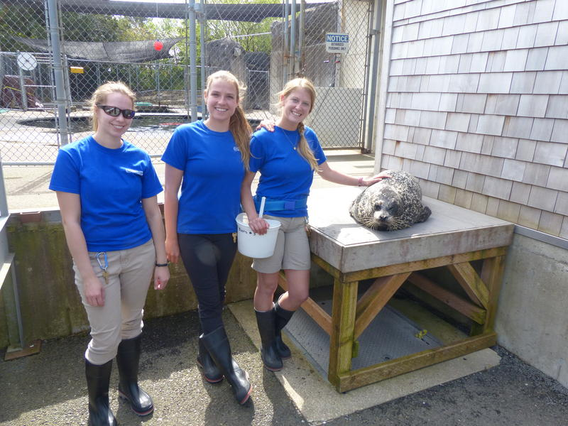 Boots with her caregivers, Brittany Blades (right).