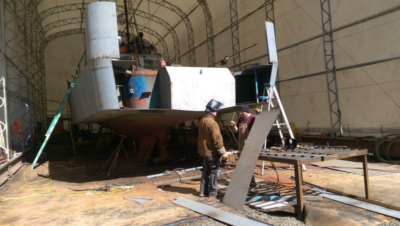 "Crews sponsoning ""The Redeemer"" at the Port of Toledo shipyard."
