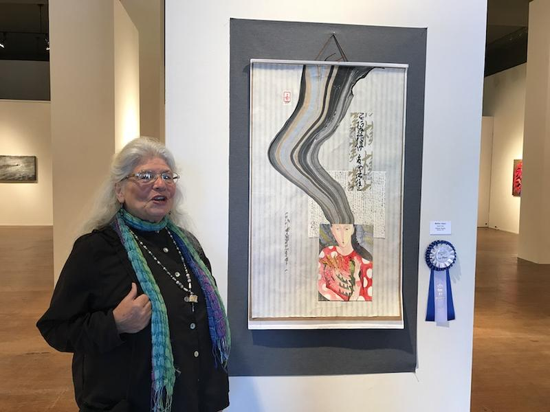 "Victoria Tierney and her prize winning painting, ""Mother Japan"""