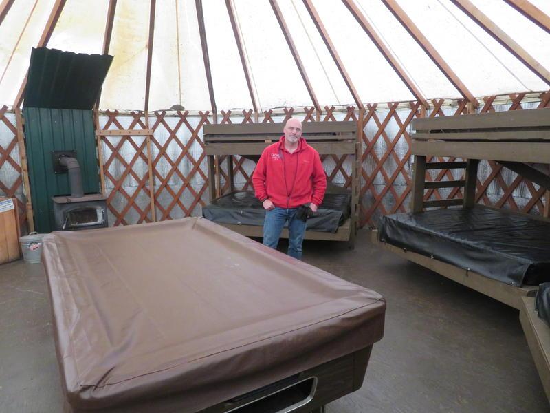 John Winslow stands inside a yurt at Camp Dakota, near Scotts Mills
