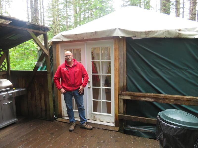 John WInslow outside yurt at Camp Dakota