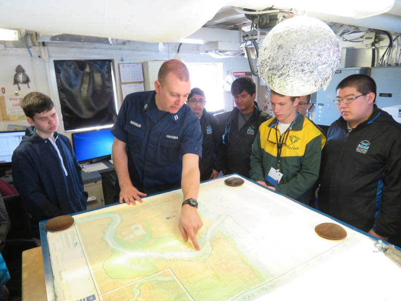 Students visit the plotting room of the Fairweather, where charting is done.