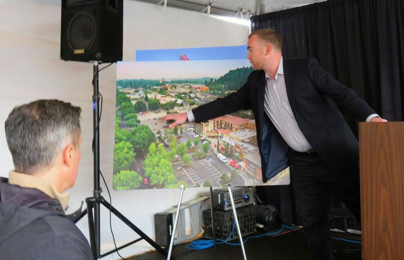 Obie Companies VP Casey Barrett displays a rendering of the planned expansion.