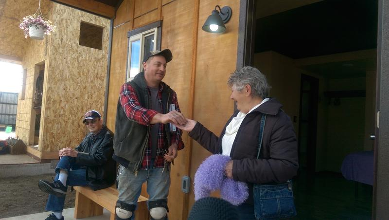 Alice Gentry gets the key to her tiny house.