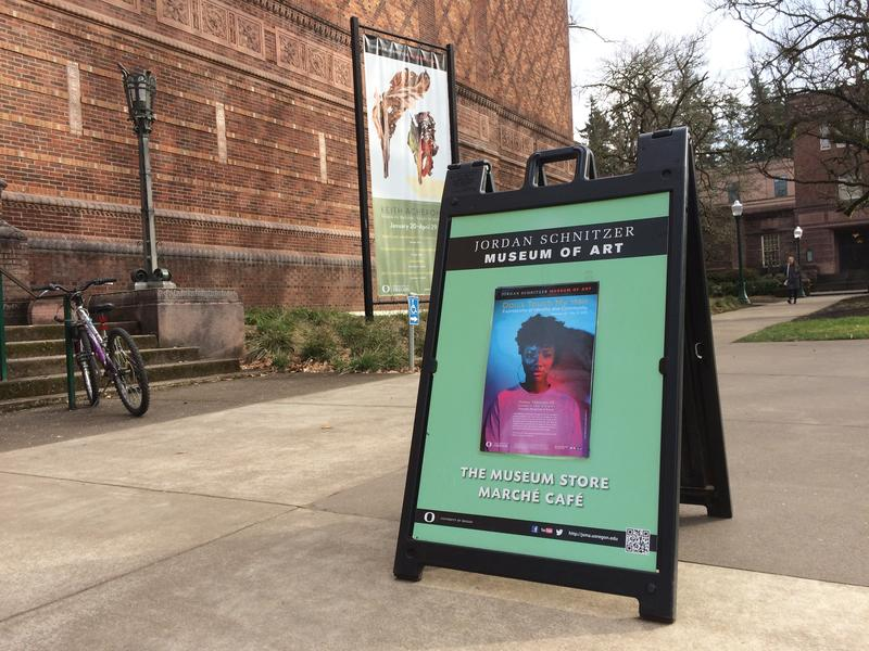 A sign for the 'Don't Touch My Hair' exhibition sits outside the Jordan Schnitzer Museum of Art at the University of Oregon on its opening day, February 23, 2018