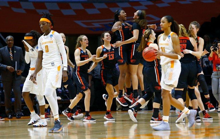Oregon State's players celebrated as Tennessee's Rennia Davis and Jaime Nared walked off the court following the Beavers' upset of the No. 3-ranked Lady Vols.
