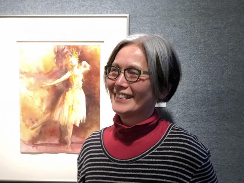 Painter Satoku Matouji with one of her paintings for the Eugene ballet's performance of Peer Gynt.