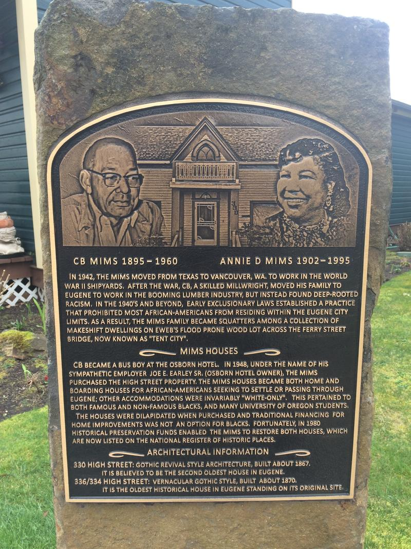 A memorial acknowledges the life and work of the Mims family in front of the Mims House