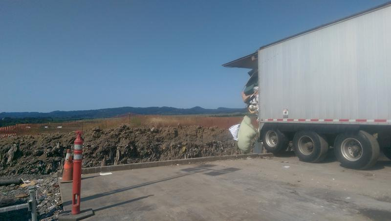 A truck dumps trash at Short Mountain Landfill